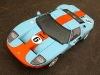 New for 2006, the limited-edition Ford GT 'Heritage' paint livery, one of the most memorable looks in Ford racing history, features a Heritage Blue with Epic Orange-striped exterior and four white 'roundels' allowing customers to apply the number of their choice. (08/19/05)